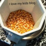 wondermill-junior-deluxe-hand-grinder-grinding-popcorn-kernels